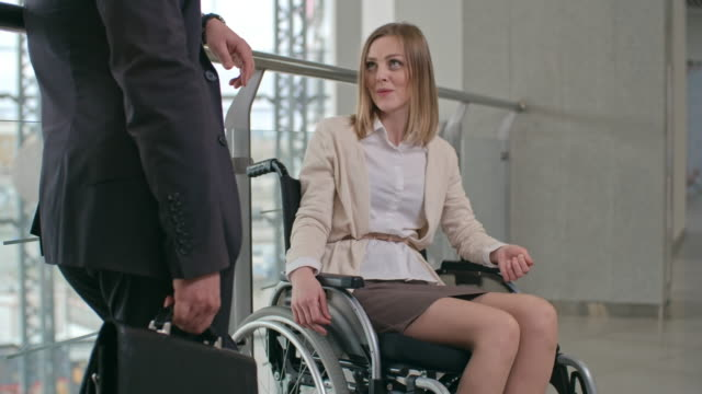 Businessman Talking to a Colleague with Disability video