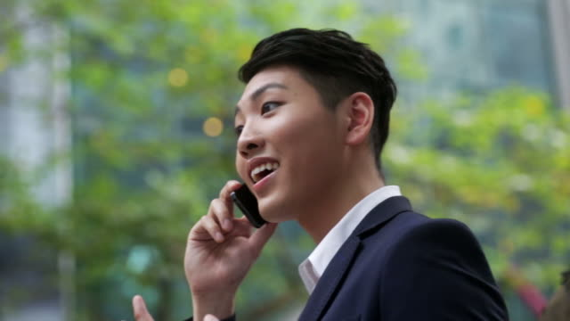Businessman talking with phone in the street video