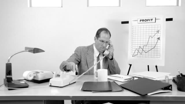 Businessman talks on telephone video