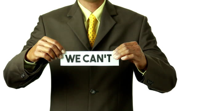 Businessman tear the paper for turning word 'WE CAN'T' into 'WE CAN' video