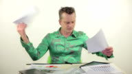 Businessman tearing and trashing papers with anger video