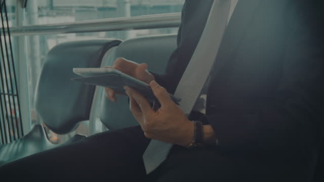 Businessman texting on Tablet video