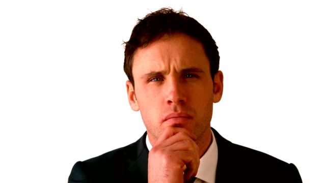 Businessman thinking with hand on chin video