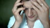 Businessman tired from crisis and working with hands over face video