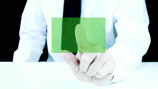 Businessman touching a blank transparent virtual screen. video