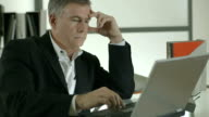 businessman typing and thinking about a problem video