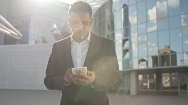Businessman Typing Message on Mobile Phone video