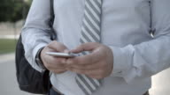4K: Businessman Typing On His Smart Phone. video