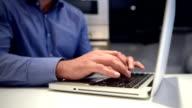 Businessman typing on laptop keyboard video