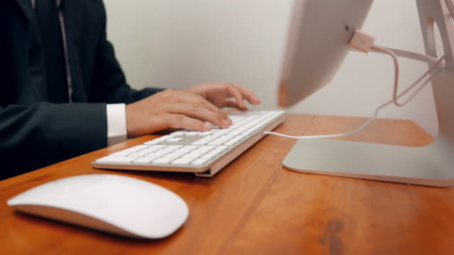 Businessman typing on laptop video