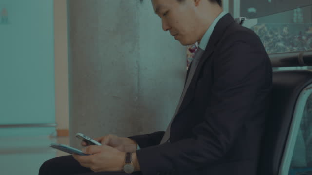 Businessman using a mobile phone video