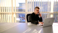 Businessman Using a Phone at the Office video