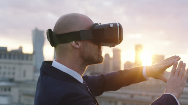 Businessman using a virtual reality glasses on the roof video