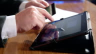 Businessman using credit card and digital tablet for online payment video