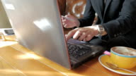 Businessman using credit card for financial transactions online with laptop video