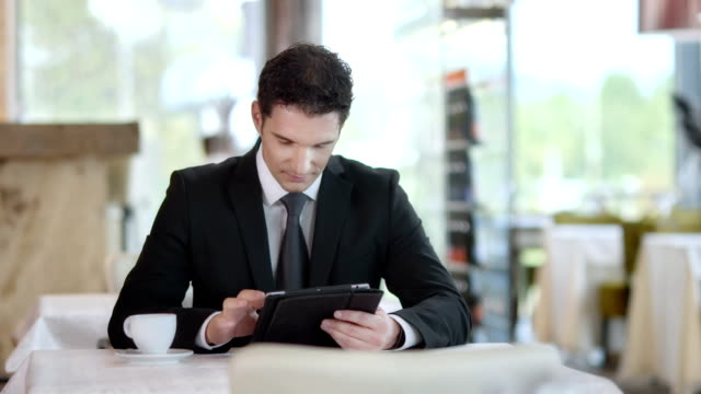 HD DOLLY: Businessman Using Digital Tablet At The Café video