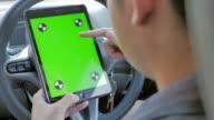 Businessman using digital tablet in car,Green screen video