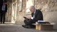 HD DOLLY: Businessman Using Digital Tablet On Street video
