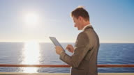 Businessman using digital tablet on the ship video