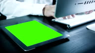 Businessman using digital tablet touchscreen ,Chroma key. video