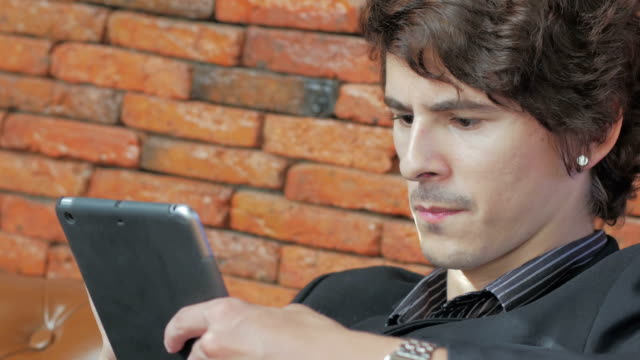 Businessman using digital tablet video