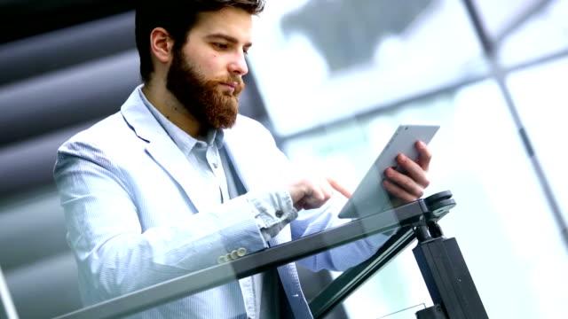 Businessman using digital tablet. video