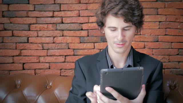 Businessman using digital tablet,Dolly shot video