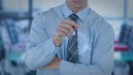 Businessman using futuristic interface screen video