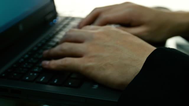 Businessman using laptop video