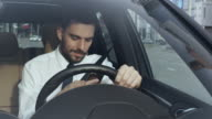 Businessman using Mobile Phone in a Car video