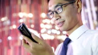 Businessman using phone at night video