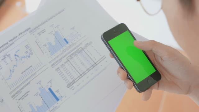 Businessman using smart phone,Green screen video