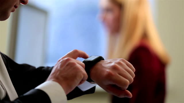 Businessman using smart Watch in the office. Close-up. video