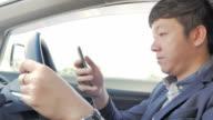 Businessman using smartphone in car,Close-up video