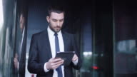 Businessman Using Tablet Computer Outdoors video