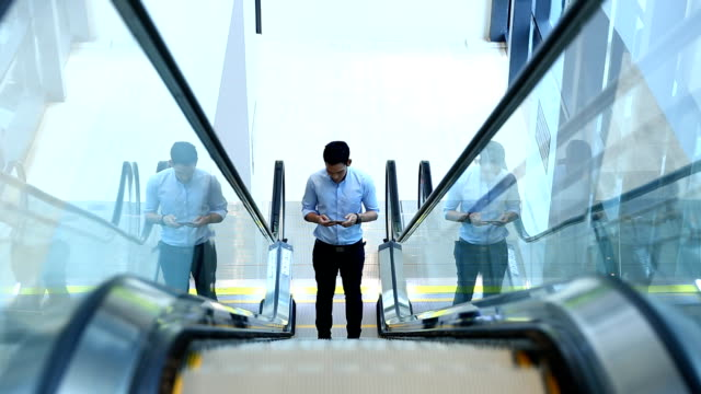 Businessman using Tablet escalator video