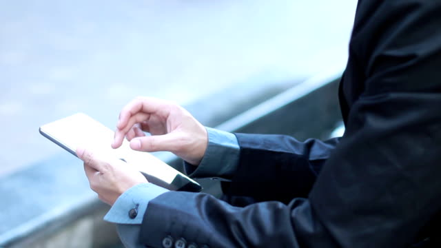 Businessman using tablet for business. video