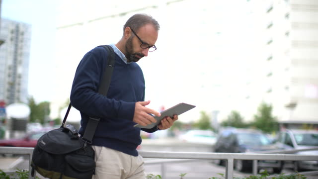 Businessman using tablet video