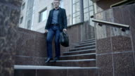 Businessman Walking Down The Stairs With His Bag video