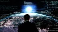 Businessman walking on digital generated earth video