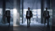 Businessman Walking on Streets of Business District Towards Camera video