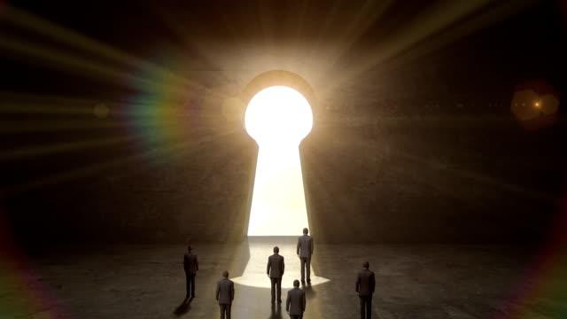 Businessman walking through shape of Keyhole.black wall. video