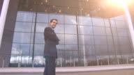 Businessman walks into city office video