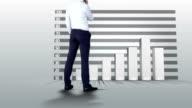 Businessman watching progress graph with arrow video