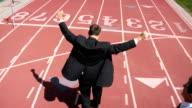 Businessman winning race video