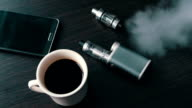 businessman with an e-cigarette on the stylish table video