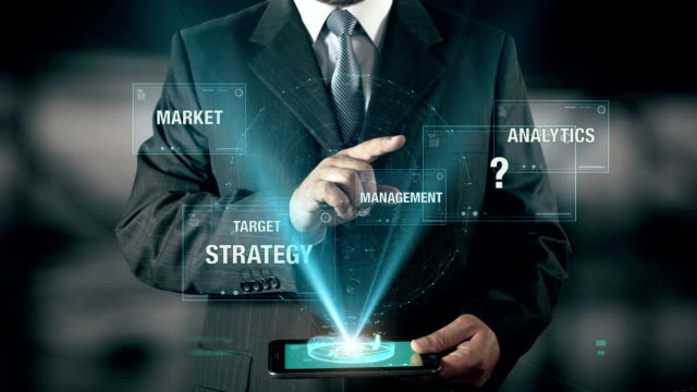 Businessman with Approach concept choose from Management Target Analytics Market Strategy using digital tablet video