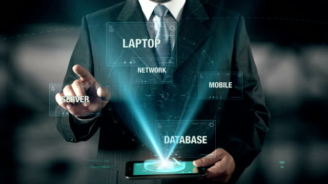 Businessman with Cloud Computing concept choose Mobile from Network Database Server Laptop using digital tablet video