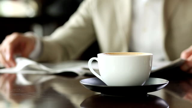 Businessman with coffee and newspaper video