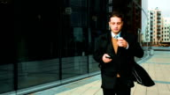 Businessman with coffee outdoor video
